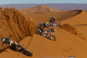 africa race motorbikes in the dunes