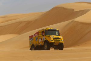 truck in sand dune at africa race